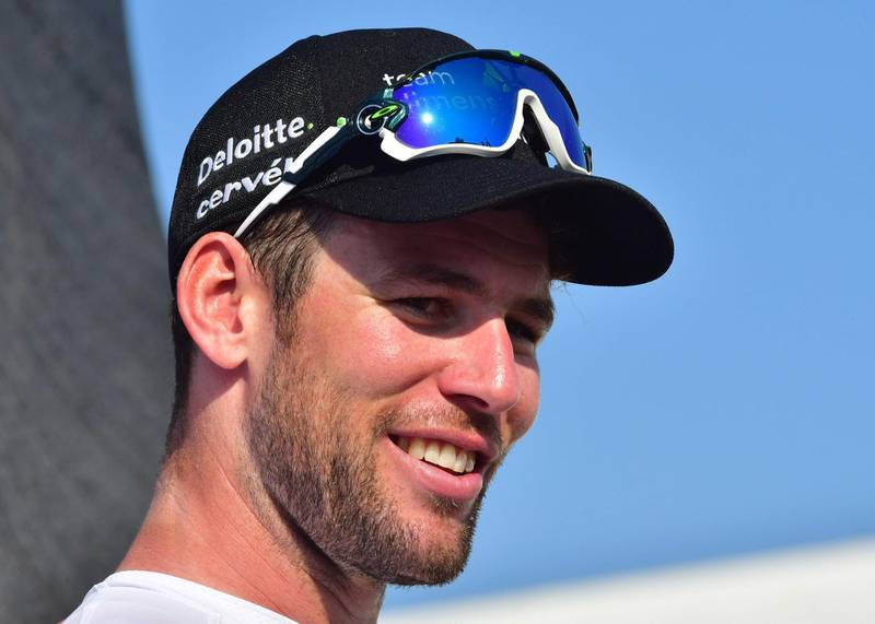 Dimension Data's British rider Mark Cavendish smiles on the podium after his victory in the third stage of the Dubai Tour, from Sky Dive Dubai to Fujairah on February 8, 2018. / AFP PHOTO / GIUSEPPE CACACE