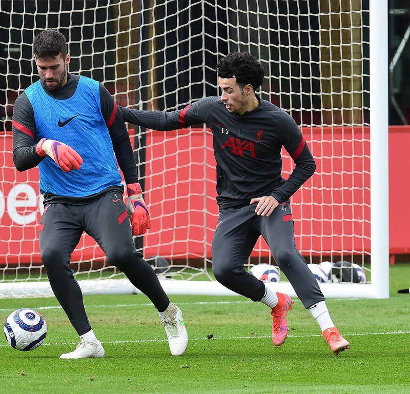 KIRKBY, ENGLAND - APRIL 28:(THE SUN OIUT. THE SUN ON SUNDAY OUT) Alisson Becker and Curtis Jones of Liverpool during a training session at AXA Training Centre on April 28, 2021 in Kirkby, England. (Photo by John Powell/Liverpool FC via Getty Images)