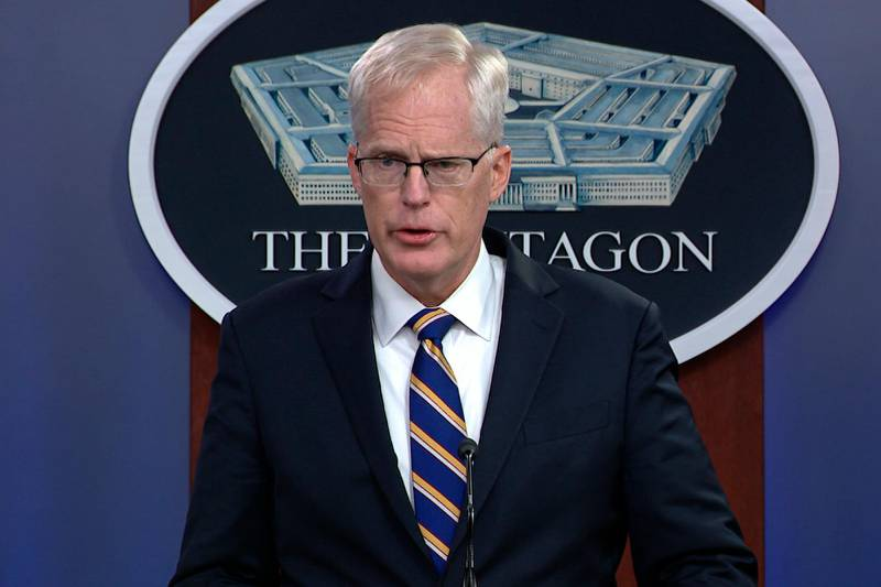 In this Tuesday, Nov. 17, 2020, image taken from a video provided by Defense.gov Acting Defense Secretary Christopher Miller speaks at the Pentagon in Washington. Miller said Tuesday that the U.S. will reduce troop levels in Iraq and Afghanistan by mid-January, asserting that the decision fulfills President Donald Trump's pledge to bring forces home from America's long wars even as Republicans and U.S. allies warn of the dangers of withdrawing before conditions are right. (Defense.gov via AP)