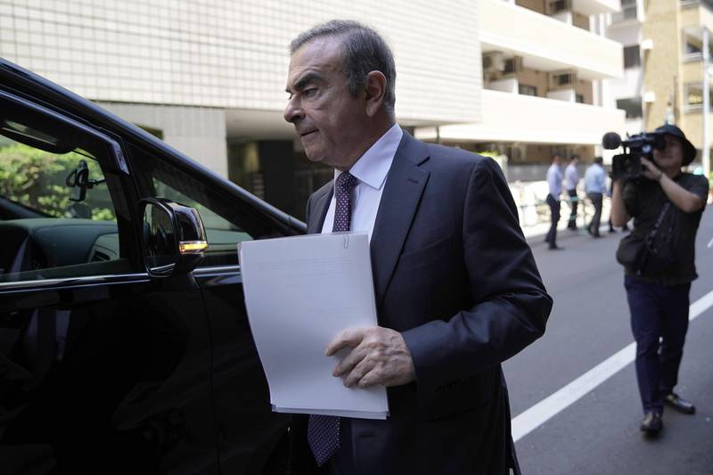 Carlos Ghosn, former chairman of Nissan Motor Co., walks towards a vehicle as he leaves his lawyer's office in Tokyo, Japan, on Thursday, May 23, 2019. Pre-trial hearings for Ghosn began Thursday at the Tokyo District Court's 17th Criminal Court Division, kicking off a new phase in a saga that began in November when Ghosn was arrested just after landing at Haneda Airport on a private jet. Photographer: Toru Hanai/Bloomberg