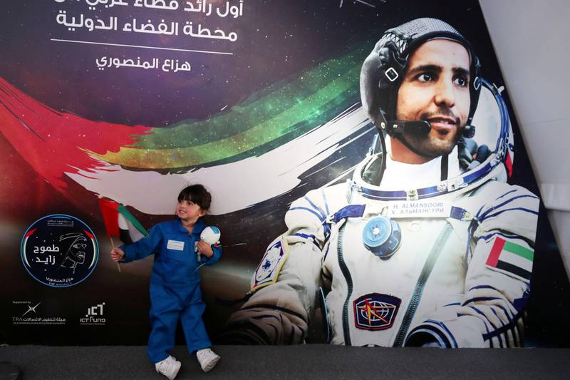 Dubai, United Arab Emirates - September 25, 2019: People attend a live screening of launch of first UAE astronaut into space. Wednesday the 25th of September 2019. Mohammed Bin Rashid Space Centre, Dubai. Chris Whiteoak / The National