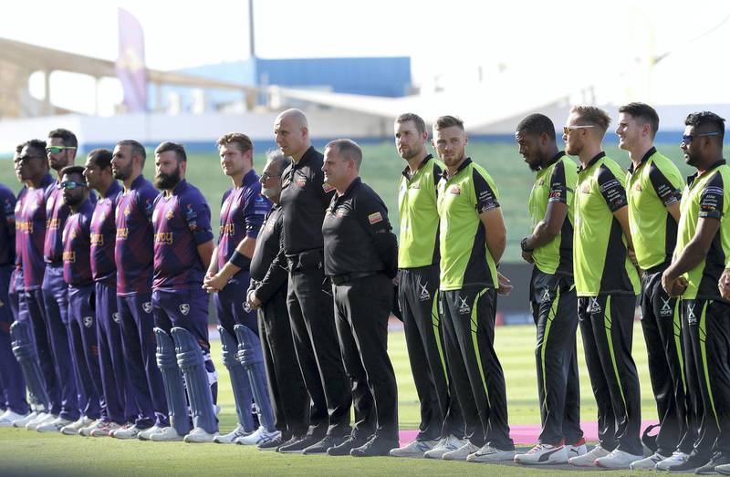 ABU DHABI , UNITED ARAB EMIRATES , Nov 19 – 2019 :- Players of Qalanders ( right ) and  Deccan Gladiators (left) observing a minute of silence in memory of  Late Sheikh Sultan bin Zayed Al Nahyan before the start of  Abu Dhabi T10 Cricket match between Qalanders vs Deccan Gladiators at Sheikh Zayed Cricket Stadium in Abu Dhabi. ( Pawan Singh / The National )  For Sports. Story by Paul