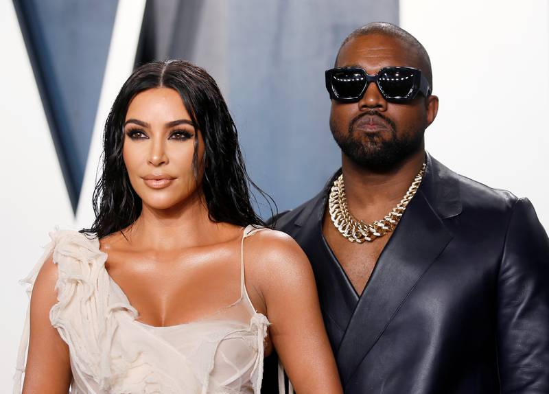 FILE PHOTO: Kim Kardashian and Kanye West attend the Vanity Fair Oscar party in Beverly Hills during the 92nd Academy Awards, in Los Angeles, California, U.S., February 9, 2020.      REUTERS/Danny Moloshok -/File Photo