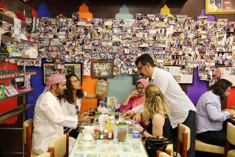 DUBAI , UNITED ARAB EMIRATES , January 9 ��� 2019 :- Majeed Al Ustad , owner ( right ) serving tea to his customers at the Ustad Special Kabab Iranian restaurant in Bur Dubai in Dubai. ( Pawan Singh / The National ) For News. Story by Nick Webster