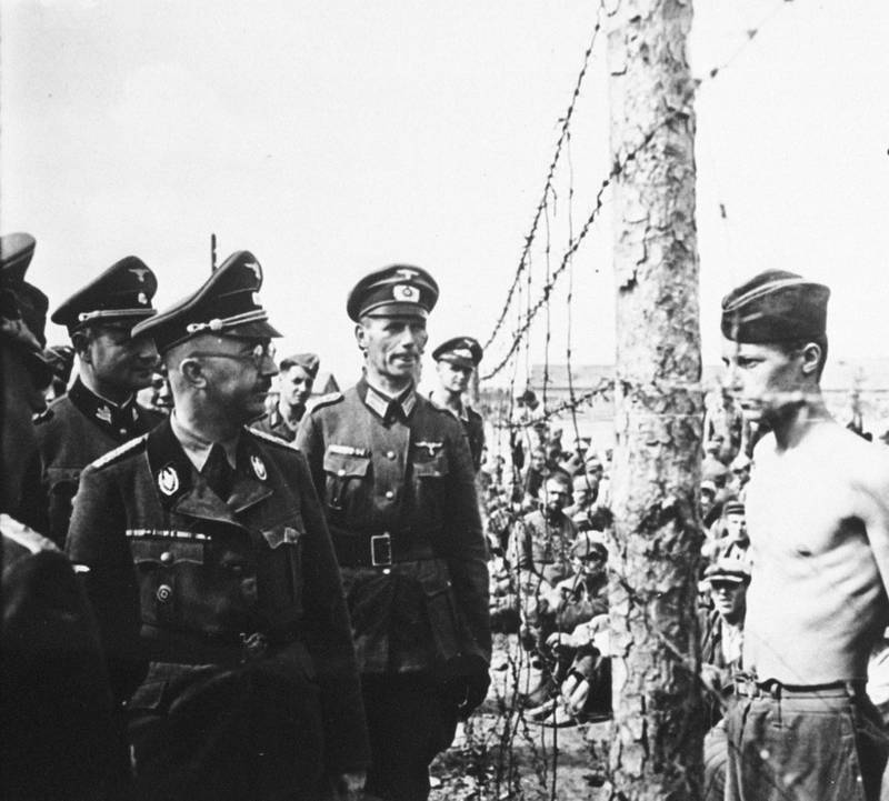 377234 21: UNDATED FILE PHOTO: Heinrich Himmler, front center in glasses, Reichsfuhrer-SS, head of the Gestapo and the Waffen-SS, Minister of the Interior from 1943 to 1945, inspects a prisoner-of-war camp in this undated file photo from 1940-41 in Russia. Himmler was the organizer of the mass murder of Jews in the Third Reich. (Courtesy of the National Archives/Newsmakers