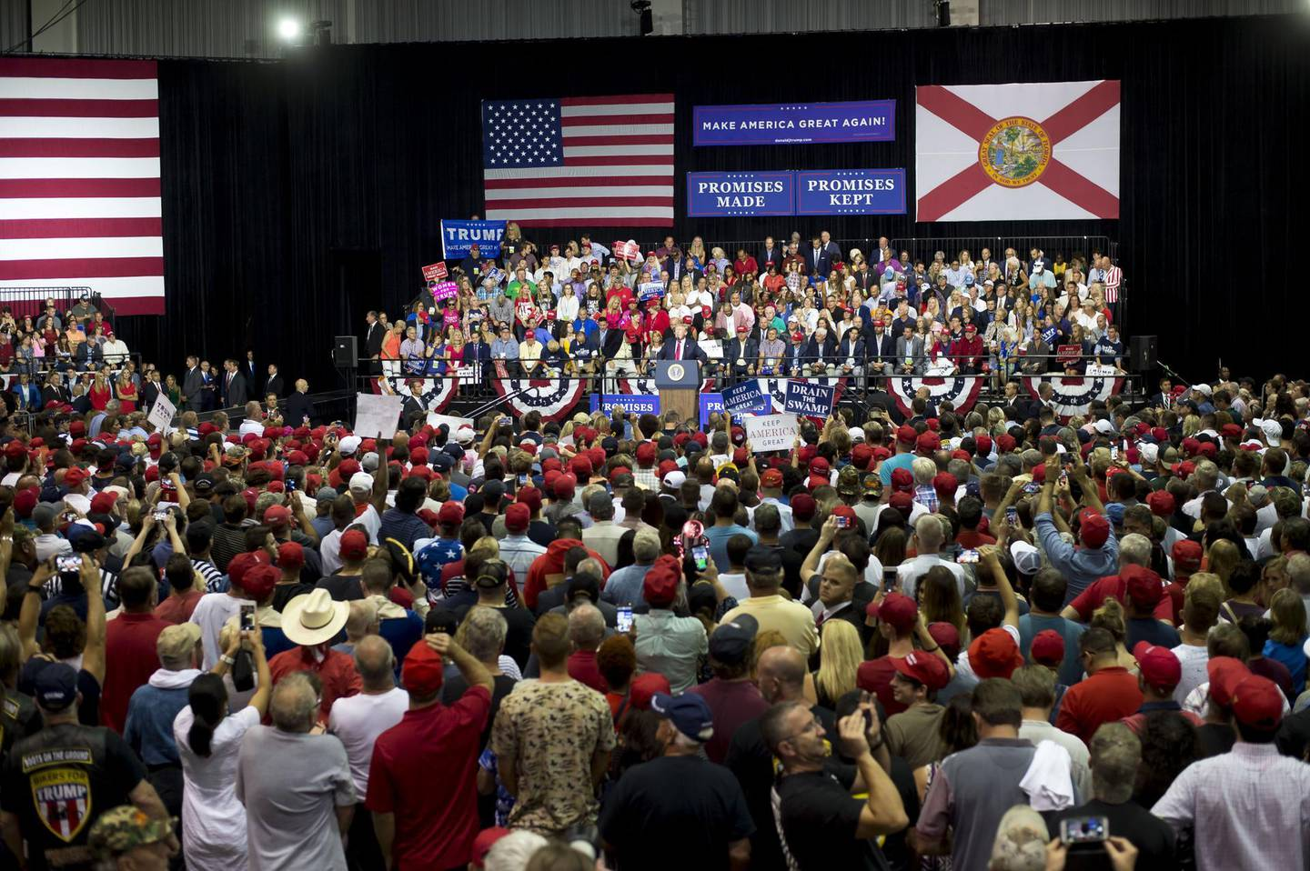"""U.S. President Donald Trump, center, addresses the crowd during a rally in Tampa, Florida, U.S., on Tuesday, July 31, 2018. Iranian Foreign Minister Javad Zarif pushed back on Trump's suggestion that he'd be willing to meet President Hassan Rouhani with """"no preconditions,"""" saying the two countries spent plenty of time in negotiations already. Photographer: Zack Wittman/Bloomberg"""