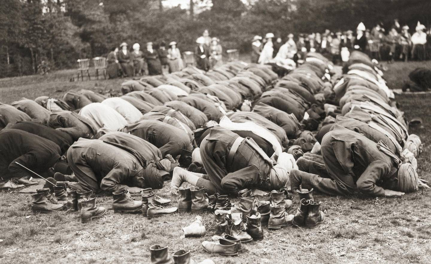 Indian troops serving with the British Army pray outside the Shah Jahan Mosque in Woking, Surrey, during the Muslim festival of Baqrid, or Eid al-Adha, (Festival of Sacrifice), circa 1916. (Photo by FPG/Hulton Archive/Getty Images)