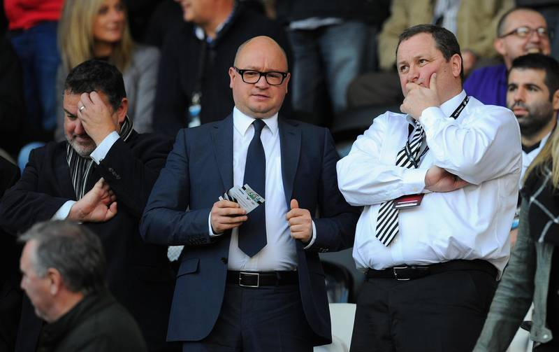 FILE: Premier League club Newcastle United have been put up for sale by owner Mike Ashley SWANSEA, WALES - OCTOBER 04:  Newcastle United owner Mike Ashley (r) chats with managing director Lee Charnley before the Barclays Premier League match between Swansea City and Newcastle United at Liberty Stadium on October 4, 2014 in Swansea, Wales.  (Photo by Stu Forster/Getty Images)
