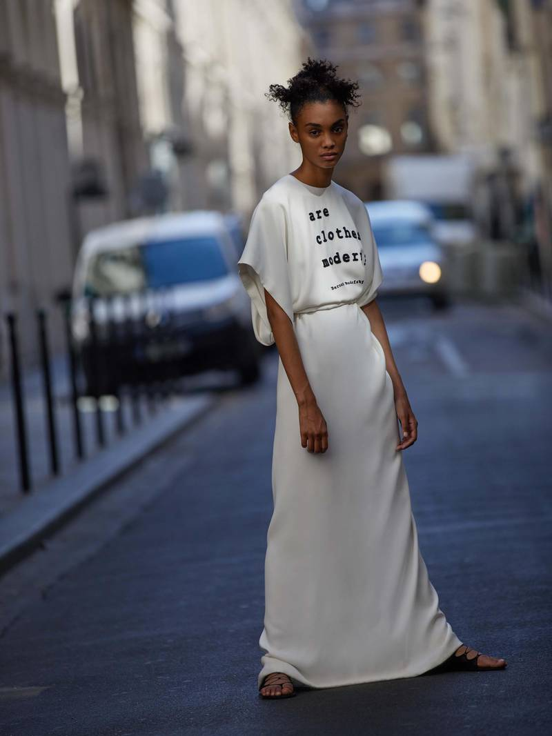 through the lens: Photography   Chantelle Dosser fashion director   Sarah MaiseyPeplos dress in white silk cady, with quote by Bernard Rudofsky, Dior Haute CoutureAll prices on request