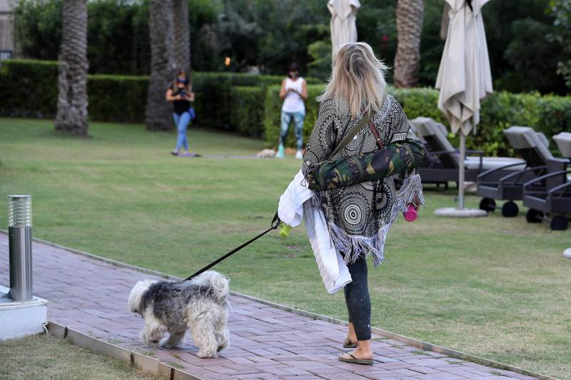 DUBAI, UNITED ARAB EMIRATES , October 28– 2020 :- Danielle Nay with her puppy Freeway arriving to attend the Puppy Pilates class held at Bounty Beets Café at the Le Méridien Mina Seyahi Beach Resort & Marina in Dubai. (Pawan Singh / The National) For Lifestyle/Online/Instagram. Story by Sophie