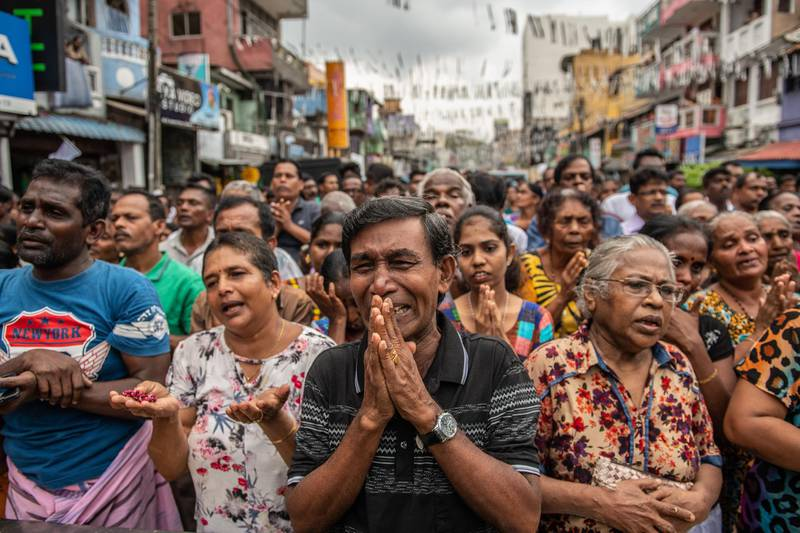 COLOMBO, SRI LANKA - APRIL 28: Sri Lankans pray in the street near St Anthony's Shrine one week on from the attacks that killed over 250 people, on April 28, 2019 in Colombo, Sri Lanka. At least 15 people, including six children, were found dead on Saturday morning in the village of Bolivarian on Sri Lanka's east coast after a raid by security forces on a house linked to the Easter suicide bombings. Based on reports, the Islamic State group claimed responsibility for the attacks late on Friday as the hunt for accomplices goes on in eastern Sri Lanka. More than 253 people were killed on Easter Sunday after coordinated terror attacks on three churches and three luxury hotels in the Colombo area and eastern city of Batticaloa, injuring hundreds. (Photo by Carl Court/Getty Images)