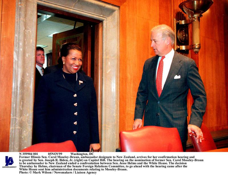 N 359904 001 05NOV99 Washington, DC Former Illinois Sen. Carol Moseley-Braun, ambassador designate to New Zealand, arrives for her confirmation hearing and is greeted by Sen. Joseph R. Biden, Jr. (right) on Capitol Hill. The hearing on the nomination of former Sen. Carol Moseley-Braun to be ambassador to New Zealand ended a confrontation between Sen. Jesse Helms and the White House. The decision Thursday by Helms, chairman of the Senate Foreign Relations Committee, to go ahead with the hearing came after the White House sent him administration documents relating to Moseley-Braun. Photo: Mark Wilson / Newsmakers / Liaison Agency