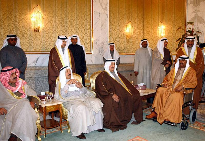 New Emir of Kuwait Sheikh Saad al-Abdullah al-Salem al-Sabah (R), Sheikh Salem al-Ali, cheif of Kuwait's national guard, and Kuwaiti Prime Minister Sheikh Sabah al-Ahmad al-Sabah (2L) receive condolences on the death of Kuwait's Emir Sheikh Jaber al-Ahmad al-Sabah, at the al-Bayan palace 17 January 2006 in Kuwait City. Kuwaitis breathed a sigh of relief at the smooth transition of power after the death of their emir, but the poor health of the oil-rich state's new ruler Sheikh Saad al-Abdullah al-Sabah, the appointment of a crown prince and other succession issues remain to be sorted out. AFP PHOTO/KUNA/HO (Photo by KUNA / AFP)