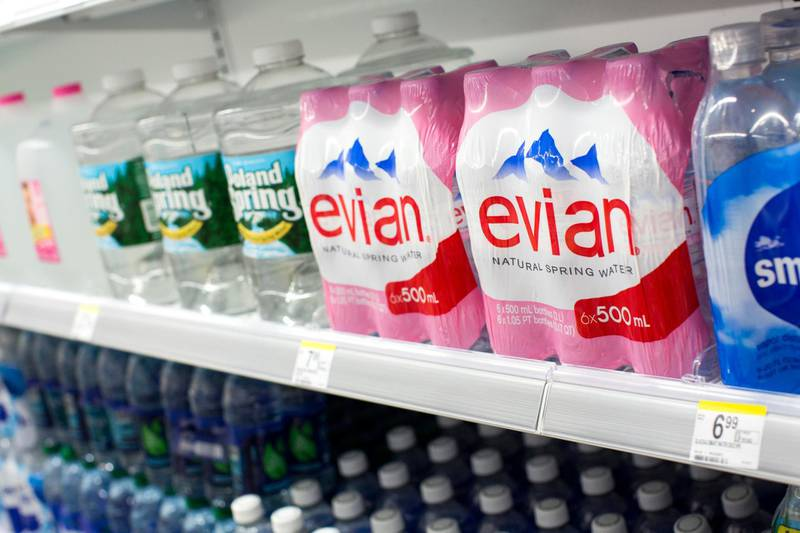 D54DJG Evian and Poland Spring bottled water on display at a Walgreens Flagship store.