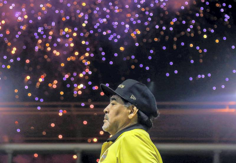 (FILES) In this file picture taken on November 29, 2018 Mexican second division football club Dorados' Argentine coach Diego Armando Maradona looks on before a match of the first round of the Final against Atletico San Luis at the Banorte stadium in Culiacan, Sinaloa State, Mexico. Argentine football legend Diego Maradona turns 60 on October 30, 2020.   / AFP / RASHIDE FRIAS