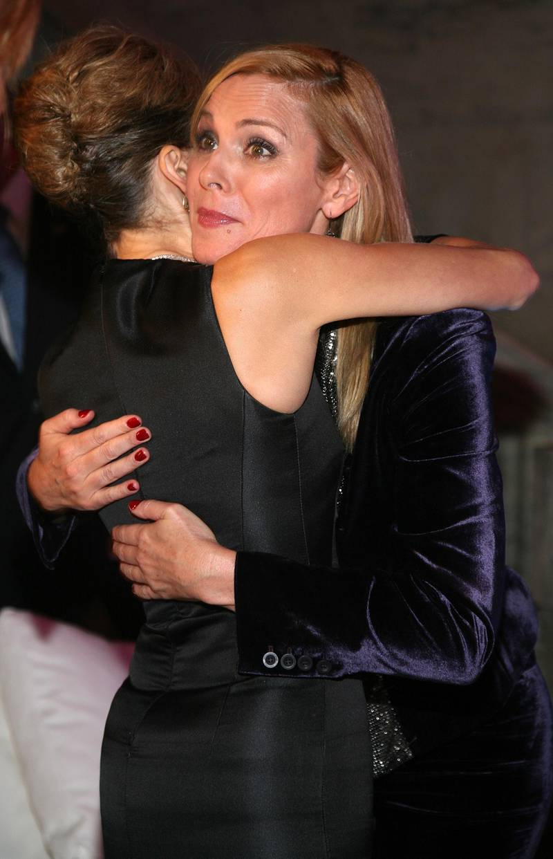 """NEW YORK - SEPTEMBER 18: (L-R) Actresses Sarah Jessica Parker and Kim Cattrall attend the """"Sex and the City: The Movie"""" DVD launch at the New York Public Library on September 18, 2008 in New York City. (Photo by Astrid Stawiarz/Getty Images)"""