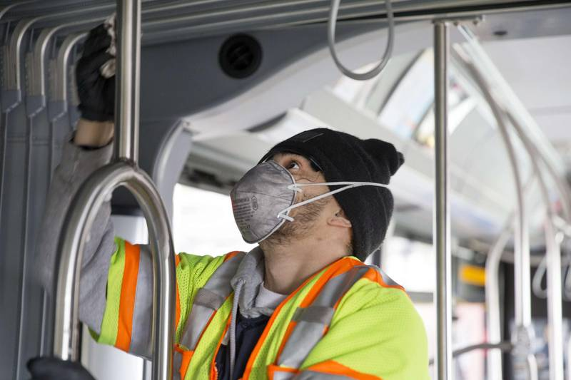 SEATTLE, WA - MARCH 03: Tyler Goodwin, a utility service worker for King County Metro, deep cleans a metro bus as part of its usual cleaning routine at the King County Metro Atlantic/Central operating base on March 3, 2020 in Seattle, Washington. Buses are deep cleaned every 30 days but later today Metro plans to ramp up their efforts to super clean buses to prevent the spread of the novel coronavirus, COVID-19 outbreak.   Karen Ducey/Getty Images/AFP == FOR NEWSPAPERS, INTERNET, TELCOS & TELEVISION USE ONLY ==