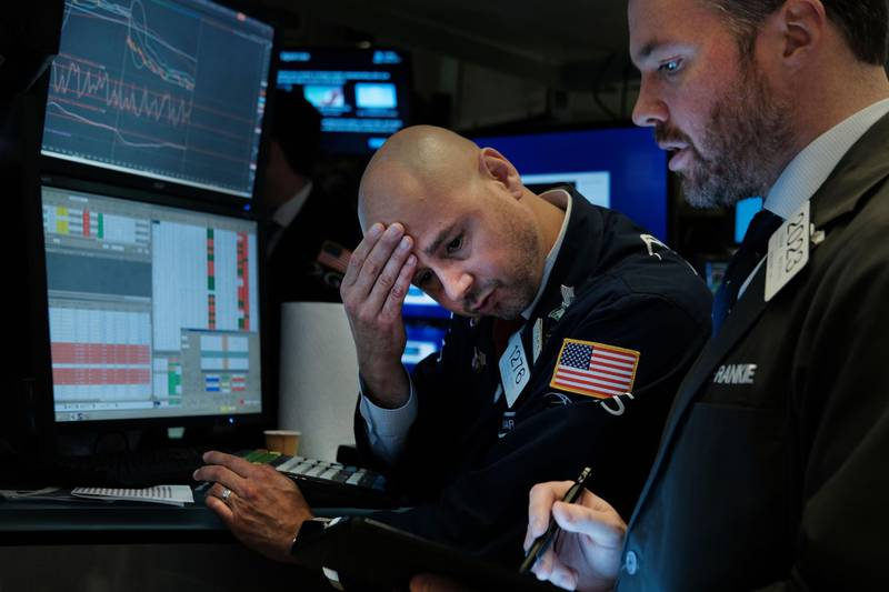 NEW YORK, NEW YORK - AUGUST 14: Traders work on the floor of the New York Stock Exchange (NYSE) on August 14, 2019 in New York City. Following news of an economic slowdown in both Germany and China, concerns over a recession in America have sent stocks plummeting with the Dow down over 800 points.   Spencer Platt/Getty Images/AFP == FOR NEWSPAPERS, INTERNET, TELCOS & TELEVISION USE ONLY ==
