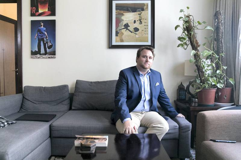 """DUBAI, UNITED ARAB EMIRATES - AUGUST 27, 2018. Zach Holz, English teacher, at his home.When Zach Holz set out to eat all of his meals at home in May, he was fairly sure he was going to reconfirm the findings of one of his favourite bloggers on the subject of financial independence, Mr Money Moustache. He was expecting nothing short of a money-saving epiphany. """"I totally didn't I didn't feel that way at all,"""" says Mr Holz, a 35-year-old American teacher living in Dubai. """"I felt trapped. I felt like I wasn't able to hang out with people I enjoyed hanging out with, because they were going out for dinner. I learned a few recipes, but I've cooked my whole life, so it's not like I learned a new skill. And I didn't save that much money either, so it kind of failed all around."""" (Photo by Reem Mohammed/The National)Reporter: ALICE HAINESection: BZ"""
