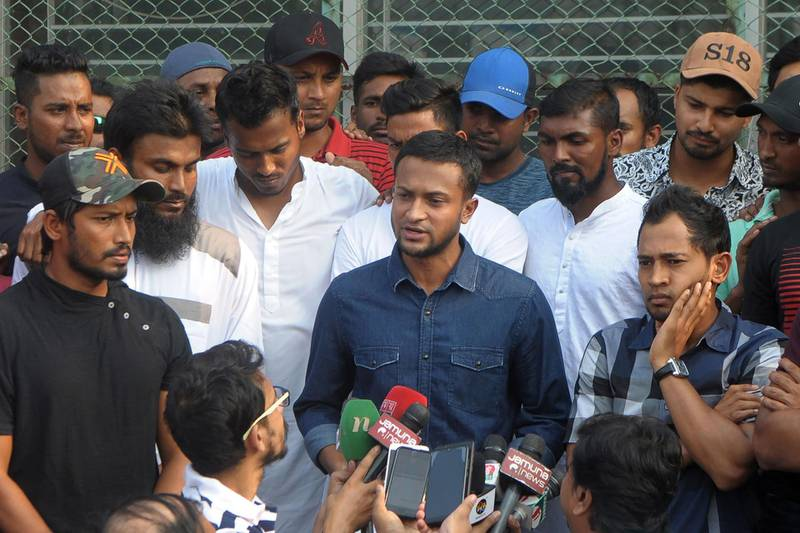 (FILES) In this file photo taken on October 21, 2019 Bangladesh national cricket team captain Shakib Al Hasan (C) speaks with journalist next to teammate Mushfiqur Rahim (R) at the Sher-e-Bangla National Stadium, in Dhaka.  Cricketers in Bangladesh's main domestic league will see match payments almost double under a new deal that ended a player strike last week, the sport's ruling body said on October 28. Players in the top-tier of the National Cricket League will receive 60,000 taka ($705) instead of 35,000 taka per four-day match, a Bangladesh Cricket Board (BCB) statement said  / AFP / STR