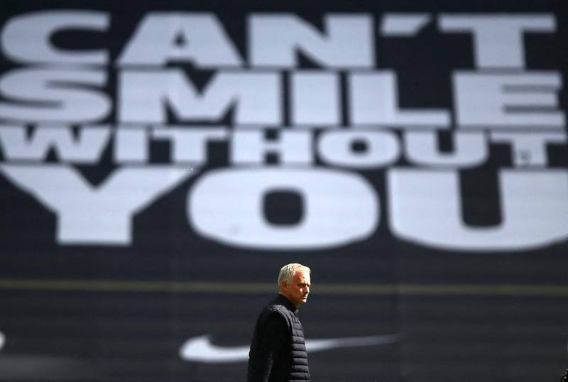 Tottenham Hotspur's Portuguese head coach Jose Mourinho walks on the pitch before the English Premier League football match between Tottenham Hotspur and Arsenal at Tottenham Hotspur Stadium in London, on July 12, 2020. (Photo by Julian Finney / POOL / AFP) / RESTRICTED TO EDITORIAL USE. No use with unauthorized audio, video, data, fixture lists, club/league logos or 'live' services. Online in-match use limited to 120 images. An additional 40 images may be used in extra time. No video emulation. Social media in-match use limited to 120 images. An additional 40 images may be used in extra time. No use in betting publications, games or single club/league/player publications. /