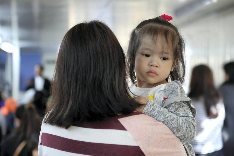 DUBAI , UNITED ARAB EMIRATES , FEB 02 – 2018 :- One of the jobless mother with her daughter listening  the guidance of Arthur Blais, Social worker at the Philippine consulate in Al Qusais 3 in Dubai. (Pawan Singh / The National) For News. Story by Ramola