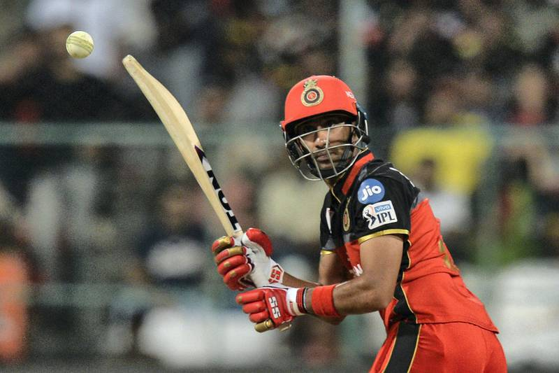 Royal Challengers Bangalore batsman Gurkeerat Singh Mann plays a shot during the 2019 Indian Premier League (IPL) Twenty20 cricket match between Royal Challengers Bangalore and Sunrisers Hyderabad at The M. Chinnaswamy stadium in Bangalore, on May 4, 2019. (Photo by Manjunath KIRAN / AFP) / IMAGE RESTRICTED TO EDITORIAL USE - STRICTLY NO COMMERCIAL USE