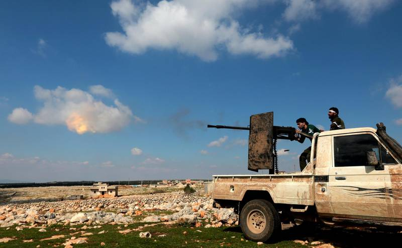 epa06600956 Turkey-backed Free Syrian Army soldiers shoot with heavy machine gun during an offensive, at Der Mismis Village, southeast of Afrin, Syria, 13 March 2018. According to media reports, the Turkish army and its allied Syrian militias on 10 March continued to encircle the city of Afrin in the Kurdish-held enclave of the same name in northwest Syrian, taking control of nine towns. The Turkish army on 20 January launched 'Operation Olive Branch' in Syria's northern regions against the Kurdish Popular Protection Units (YPG) forces and the Syrian Democratic Forces (SDF) which control the city of Afrin. Turkey classifies the YPG as a terrorist organization. The Turkish-backed Free Syrian Army is an armed rebel military group that operates in northern Syria and is supported by the Turkish army.  EPA/STR