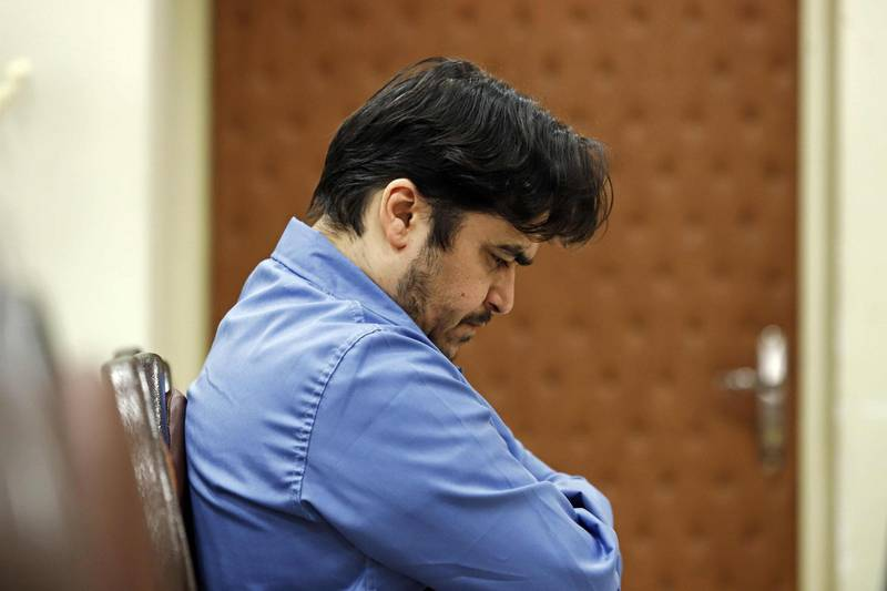 """(FILES) In this file photo taken on June 30, 2020, Ruhollah Zam, a former opposition figure who had lived in exile in France and had been implicated in anti-government protests, speaks during his trial at Iran's Revolutionary Court in Tehran. Iran Judiciary on December 7 said it had upheld a death sentence for Ruhollah Zam, a former opposition figure who had lived in exile in France and was implicated in anti-government protests. He was charged with """"corruption on earth"""" -- one of the most serious offences under Iranian law -- and sentenced to death in June. / AFP / MIZAN NEWS AGENCY / ALI SHIRBAND"""