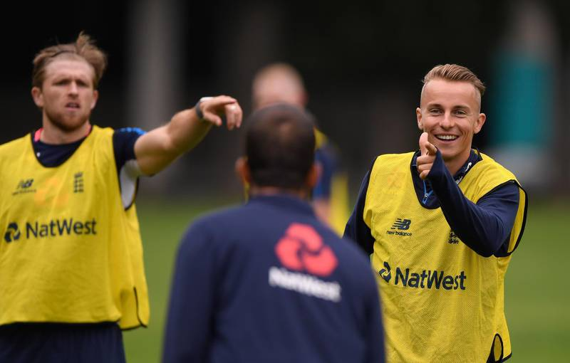 DUNEDIN, NEW ZEALAND - MARCH 6:  England player Tom Curran (r) reacts during an England training session ahead of the 4th ODI v New Zealand Black Caps at Oval on March 6, 2018 in Dunedin, New Zealand.  (Photo by Stu Forster/Getty Images)