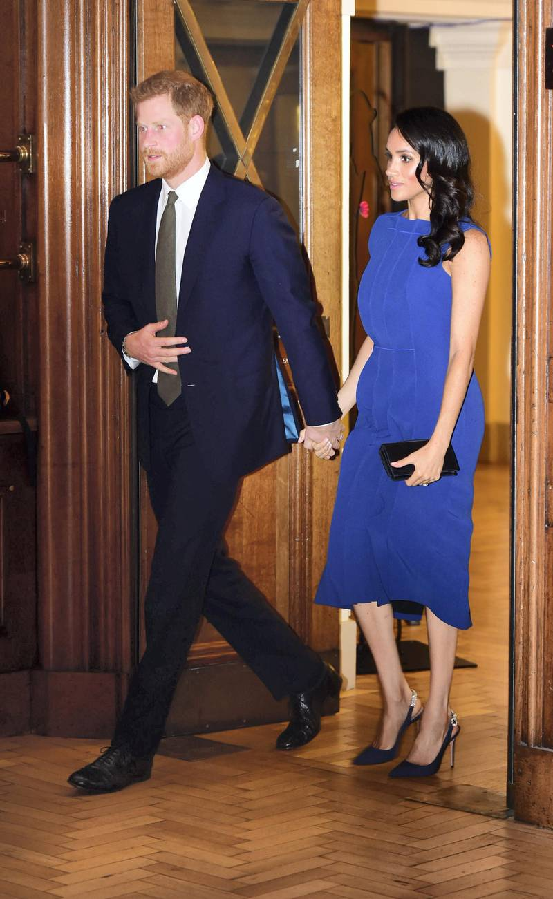 Britain's Prince Harry, Duke of Sussex, and his wife Meghan, Duchess of Sussex arrive to attend 100 Days to Peace in London on September 6, 2018, a gala music evening marking the centenary of the end of the First World War. - Presented by the Royal Armouries, the one-off concert is an evening of music and reflection in aid of three charities all working to support military veterans facing mental health challenges; Help for Heroes, Combat Stress and Heads Together ��� The Royal Foundation's campaign and mental health initiative. (Photo by Geoff PUGH / POOL / AFP)