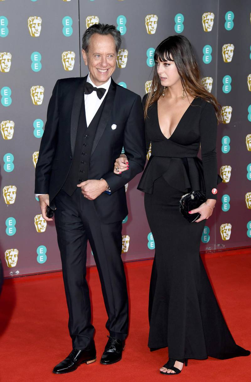 LONDON, ENGLAND - FEBRUARY 02: Richard E. Grant (L) and Olivia Grant attend the EE British Academy Film Awards 2020 at Royal Albert Hall on February 02, 2020 in London, England. (Photo by Gareth Cattermole/Getty Images)