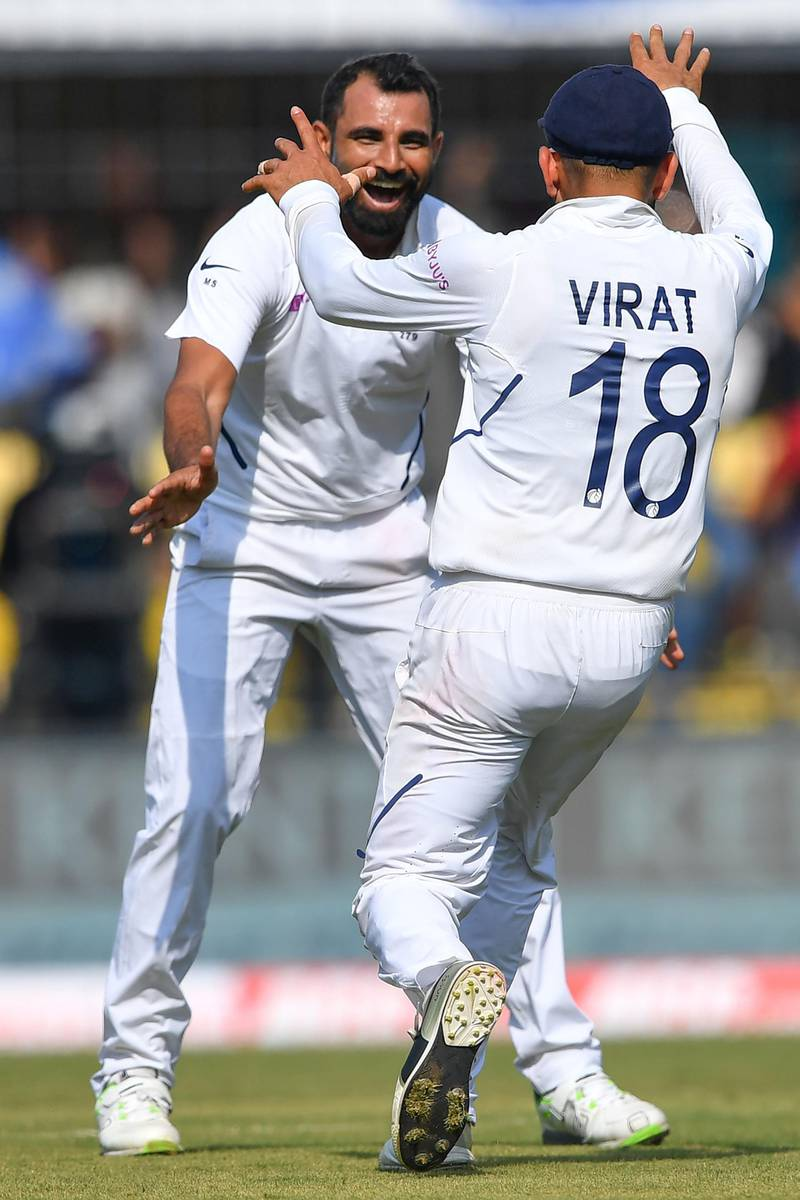 India's cricketer Mohammed Shami (L) jumps celebrates with captain Virat Kohli after the dismissal of Bangladesh's Mushfiqur Rahim during the first day of the first Test cricket match between India and Bangladesh at the Holkar Cricket Stadium in Indore on November 14, 2019.   - ----IMAGE RESTRICTED TO EDITORIAL USE - STRICTLY NO COMMERCIAL USE----- / GETTYOUT  / AFP / Indranil MUKHERJEE / ----IMAGE RESTRICTED TO EDITORIAL USE - STRICTLY NO COMMERCIAL USE----- / GETTYOUT