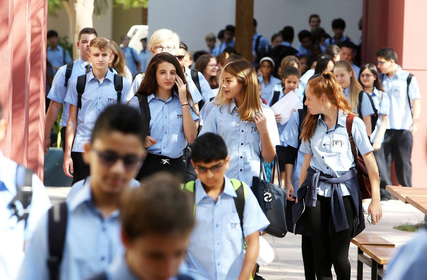 DUBAI , UNITED ARAB EMIRATES – Aug 28 , 2016 : Students going for the assembly  on the first day of school after the summer vacation at the Bradenton Preparatory Academy in Dubai Sports City in Dubai. ( Pawan Singh / The National ) For News. Story by Nadeem Hanif. ID No - 77443 *** Local Caption ***  PS2808- NEW SCHOOL YEAR01.jpg