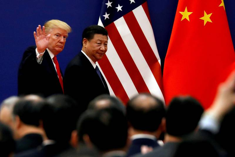 FILE PHOTO: U.S. President Donald Trump and China's President Xi Jinping meet business leaders at the Great Hall of the People in Beijing, China, November 9, 2017. REUTERS/Damir Sagolj/File Photo
