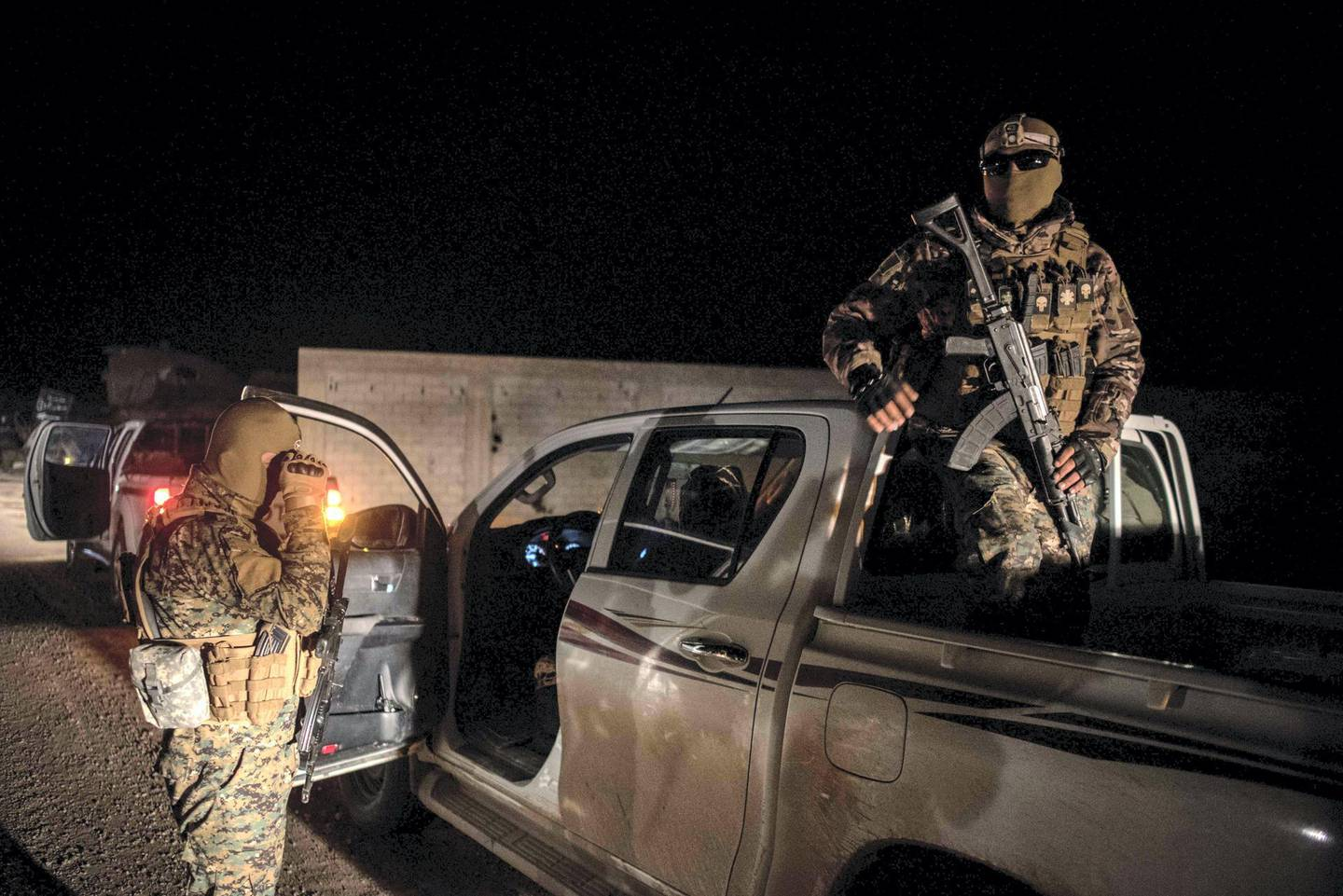 Kurdish YPG fighters stand guard outside Baghouz, Syria as fighting is ongoing to clear the bastion of the last ISIS fighters, 2 March 2019