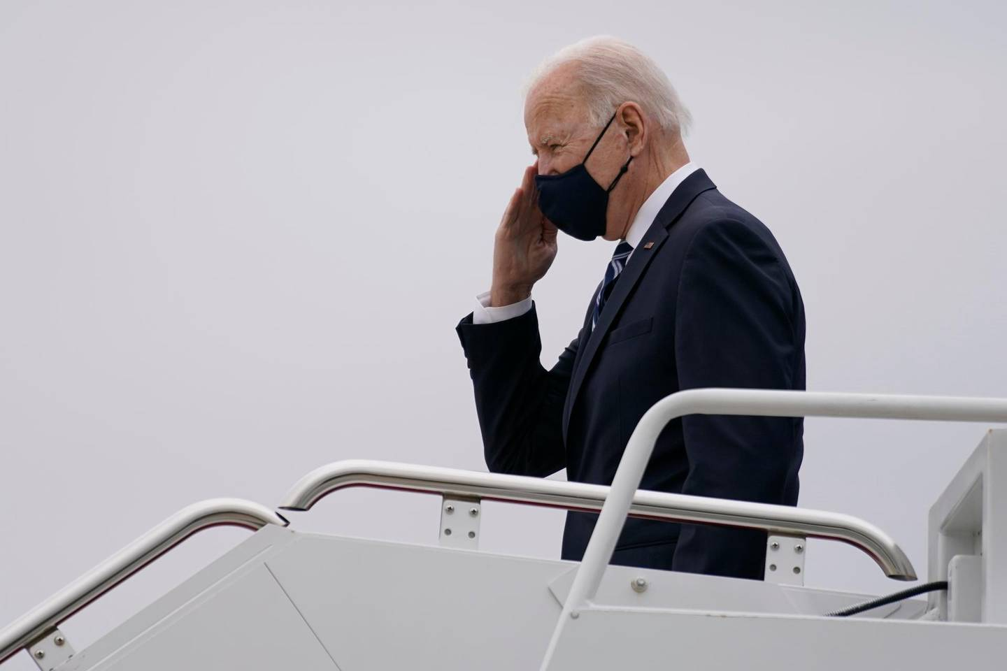 President Joe Biden pauses to salute as he boards Air Force One at Andrews Air Force Base, Md., Tuesday, March 16, 2021, en route to Philadelphia International Airport in Philadelphia. (AP Photo/Carolyn Kaster)