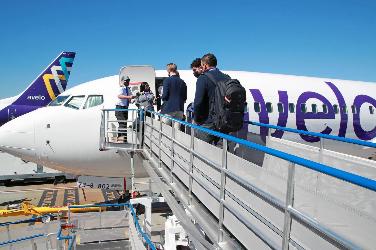 BURBANK, CALIFORNIA - APRIL 28: Passengers board the plane as Avelo Airlines takes off with first flight between Burbank and Santa Rosa at Hollywood Burbank Airport on April 28, 2021 in Burbank, California. (Photo by Joe Scarnici/Getty Images for Avelo Air)