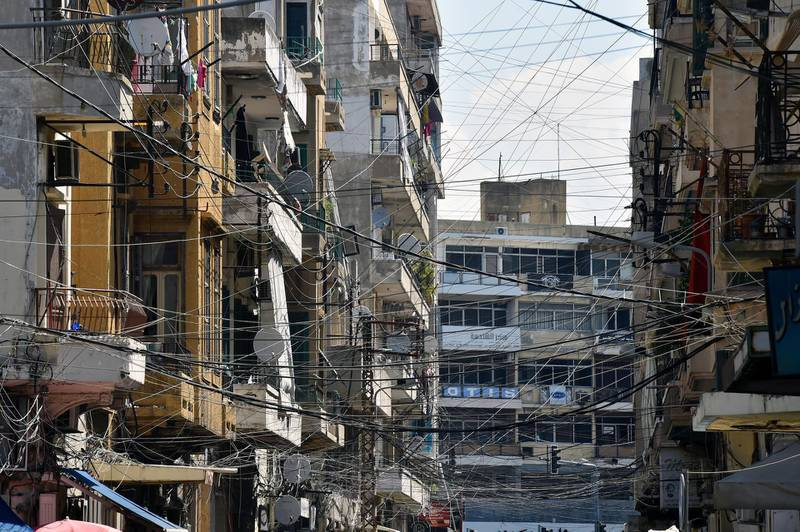 epa06920403 Electric wires connected to a generator which runs when the national power grid is down in one of Tripoli's heavily populated neighbourhoods, north Lebanon, 30 July 2018 (Issued 31 July 2018). The insufficient electricity supply has been a problem ever since the civil war, more than fourty years ago, and accompanied by a lack of practical solutions aswell.  EPA/WAEL HAMZEH