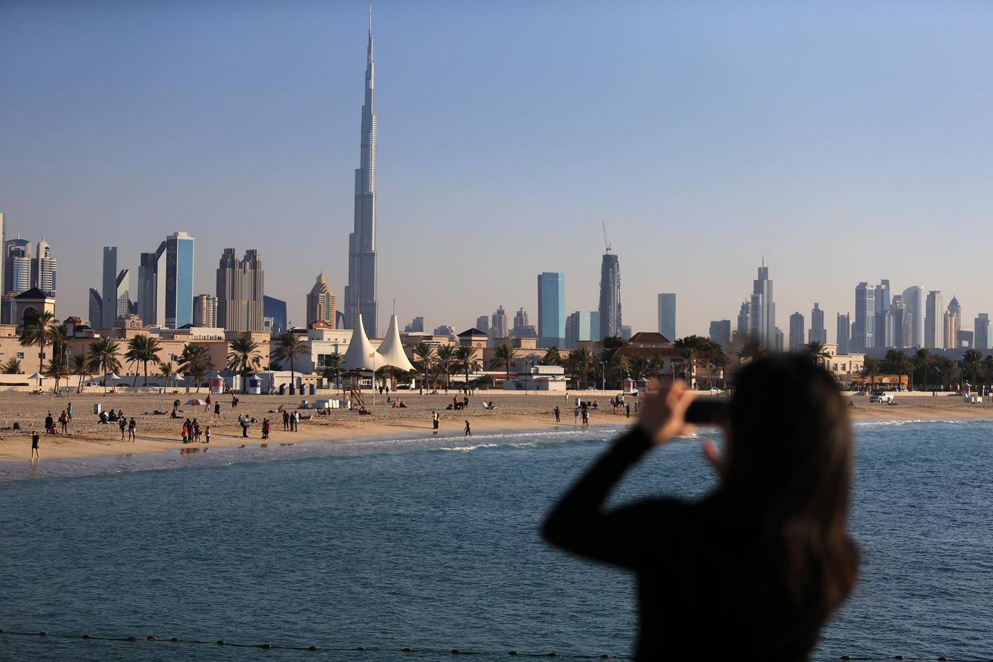 DUBAI, UAE. January 4, 2014 -  A tourist takes a photo of the skyline and the shores of Jumeirah Open Beach in Dubai, January 4, 2014.  (Photo by: Sarah Dea/The National, Story by: STANDALONE, News)