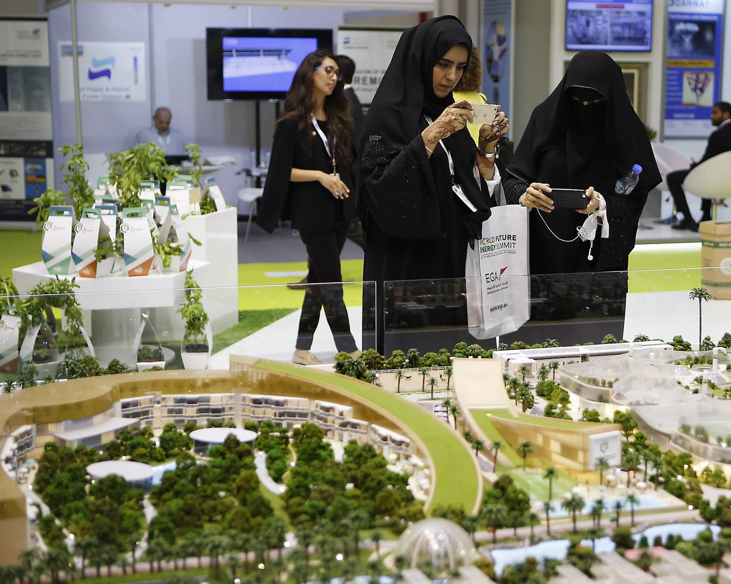 ABU DHABI, UNITED ARAB EMIRATES -17January 2017 - Visitors take photographs of Sustainable City in Dubai regions first Net Zero Operational Sustainable community model displayed at the World Future Energy Summit 2017 at the Abu Dhabi Exhibition Centre. Ravindranath K / The NationalID: 62760 (to go with LeAnne Graves, Dania Al Saadi and Tony McAuley story for Business) *** Local Caption ***  RK1701-WFES18.jpg