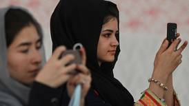 Inside the WhatsApp groups Afghan women use to organise against the Taliban