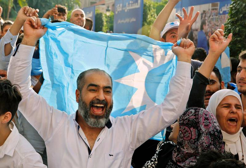 Supporters of Lebanese Prime Minister Saad Hariri, chant slogans during a celebration after Hariri's bloc won 21 seats in the parliamentary elections, paving the way for him to be named the next premier, at his house in downtown Beirut, Lebanon, Friday, May 11, 2018. (AP Photo/Bilal Hussein)