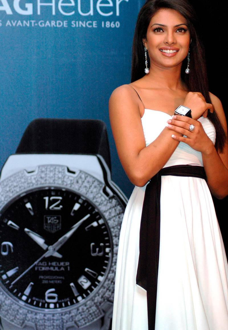 epa00954255 Bollywood film actress and former Miss World Priyanka Chopra poses with a Tag Heuer watch on in New Delhi on Modnday 12 March 2007 as Tag Heuer named Chopra as its new brand ambassador.  EPA/STR
