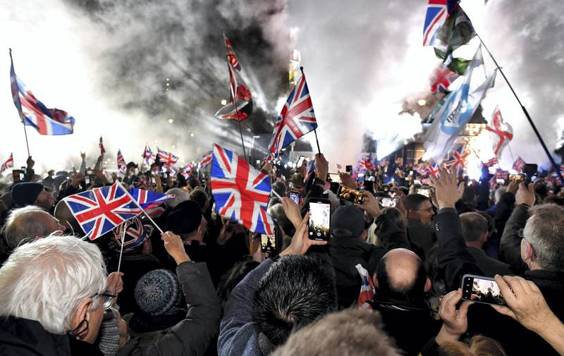 LONDON, ENGLAND - JANUARY 31: Pro Brexit supporters celebrates as the United Kingdom exits the EU during the Brexit Day Celebration Party hosted by Leave Means Leave at Parliament Square on January 31, 2020 in London, England. At 11.00pm on Friday 31st January the UK and Northern Ireland exits the European Union, 188 weeks after the referendum on June 23rd, 2016. (Photo by Jeff J Mitchell/Getty Images)