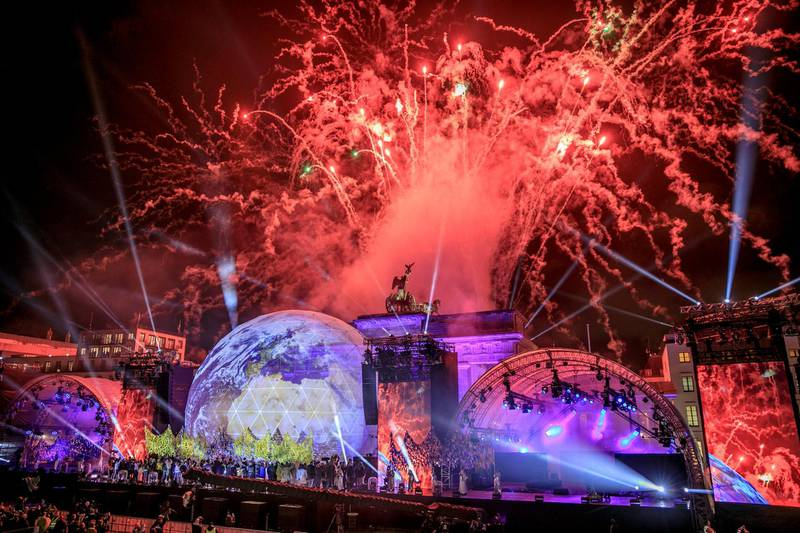 BERLIN, GERMANY - NOVEMBER 09:  Fireworks erupt over the Brandenburg Gate during celebrations on the 30th anniversary of the fall of the Berlin Wall on November 9, 2019 in Berlin, Germany. From 1961 until 1989 the Berlin Wall, built by the communist authorities of East Germany to prevent people from East Berlin fleeing into West Berlin, divided the city. Its opening in 1989 quickly led to the collapse of the East German communist government and the eventual reunification of Germany in 1991.  (Photo by Carsten Koall/Getty Images)