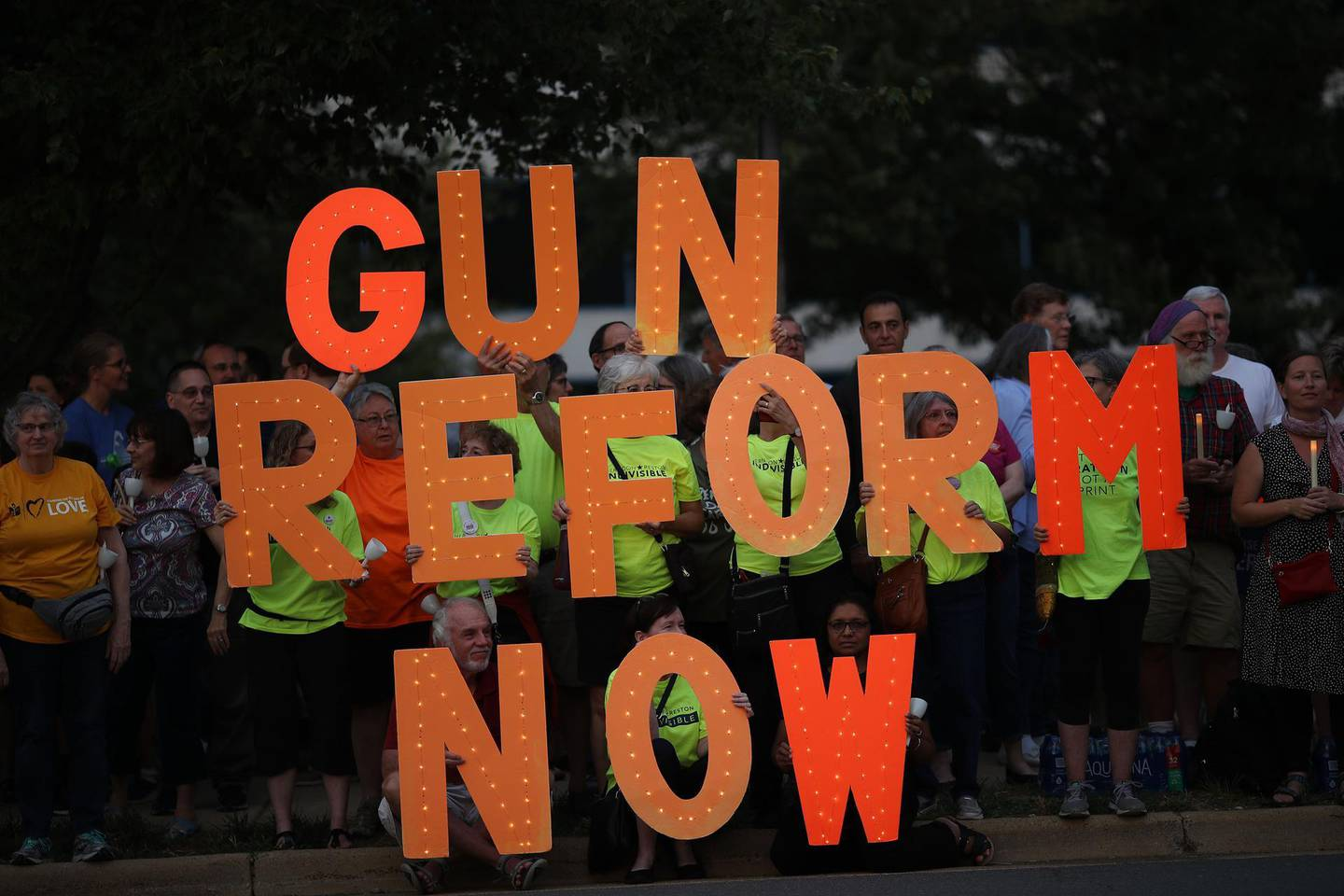 FAIRFAX, VIRGINIA - AUGUST 05: Advocates of gun reform legislation hold a candle light vigil for victims of recent mass shootings outside the headquarters of the National Rifle Association August 5, 2019 in Fairfax, Virginia. Thirty-one people have died following the two mass shootings over the weekend in El Paso, Texas and Dayton, Ohio.   Win McNamee/Getty Images/AFP == FOR NEWSPAPERS, INTERNET, TELCOS & TELEVISION USE ONLY ==