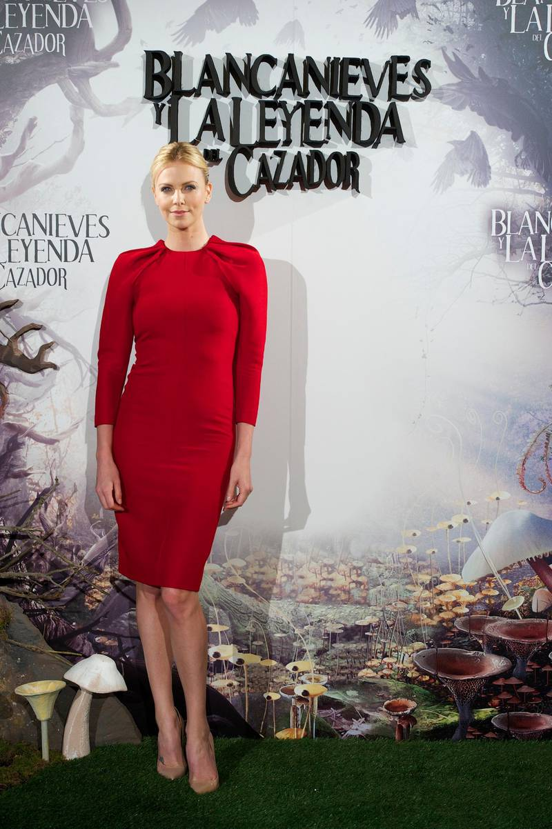 """MADRID, SPAIN - MAY 17:  Actress Charlize Theron attends """"Snow White and the Huntsman"""" (Blancanieves y la Leyenda del Cazador) photocall at Casa de America on May 17, 2012 in Madrid, Spain.  (Photo by Carlos Alvarez/Getty Images)"""