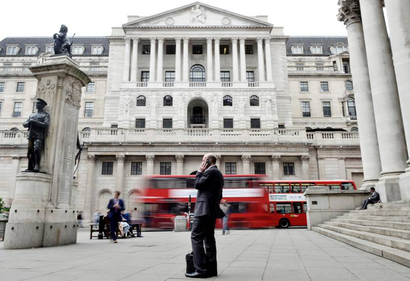 A man talks on a mobile phone as people walk past the Bank of England, in London, Britain September 21, 2017. REUTERS/Mary Turner