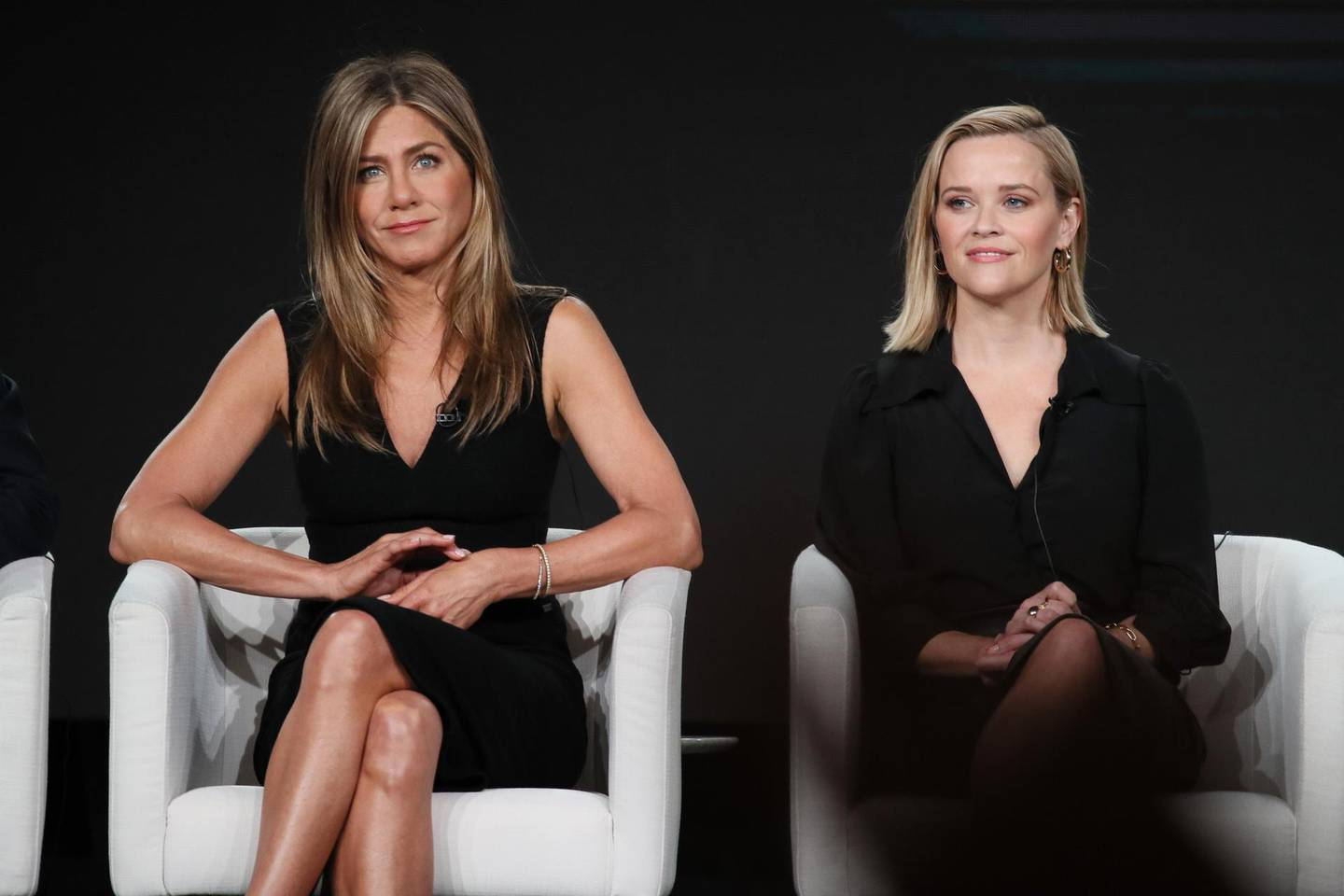 """PASADENA, CALIFORNIA - JANUARY 19: Jennifer Aniston and Reese Witherspoon of """"The Morning Show"""" speaks onstage during the Apple TV+ segment of the 2020 Winter TCA Tour at The Langham Huntington, Pasadena on January 19, 2020 in Pasadena, California.   David Livingston/Getty Images/AFP == FOR NEWSPAPERS, INTERNET, TELCOS & TELEVISION USE ONLY =="""